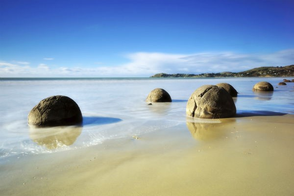 One of New Zealand's most iconic natural features, the Moeraki Boulders, are within easy reach for anyone with a Dunedin car rental.