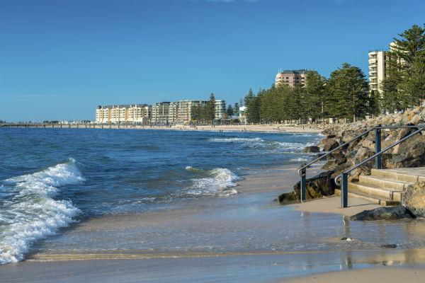If you catch a sunny day in Adelaide, head down to the golden sands of Glenelg Beach.