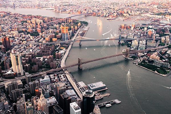 An aerial view of New York City's boroughs and bridges