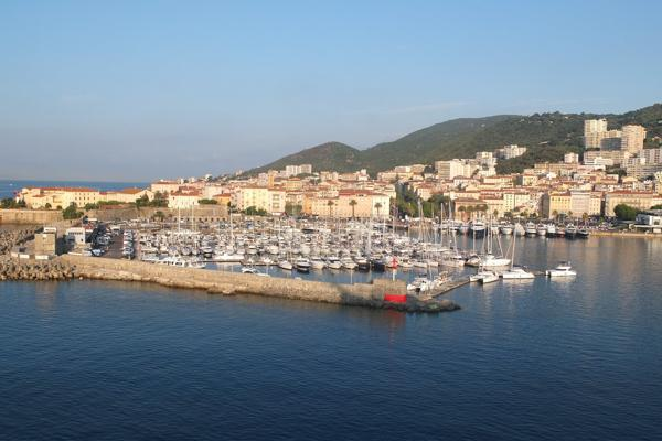 A collection of docked sailboats in the marina in Ajaccio, France