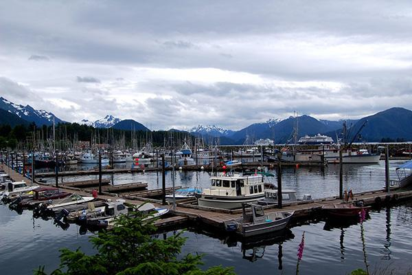 View of Sitka Harbour with mountain in the distance on a crisp, cloudy day