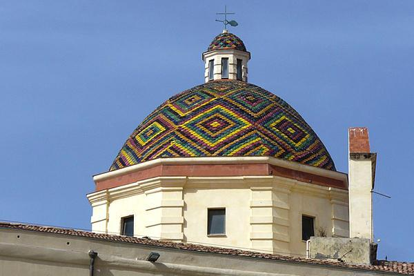 One of many colourful church domes sitting above Sardinia's Alghero