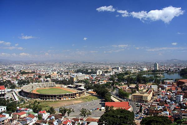 Bird's eye view of Antananarivo, Madagascar, with a stadium and a pond in the centre of town