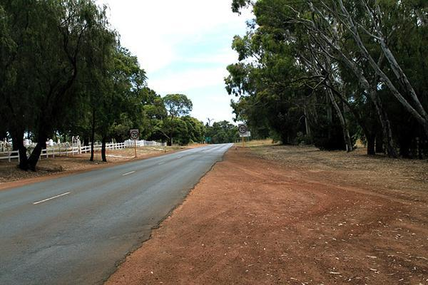 A country road in Manjimup dusted with the iconic red dirt of Western Australia