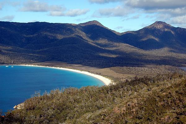 Wineglass Bay with its green mountain backdrop in Freycinet National Park, Tasmania