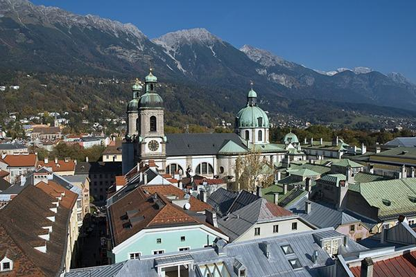 View of the city's rooftops with a mountain backdrop in Innsbruck, Austria