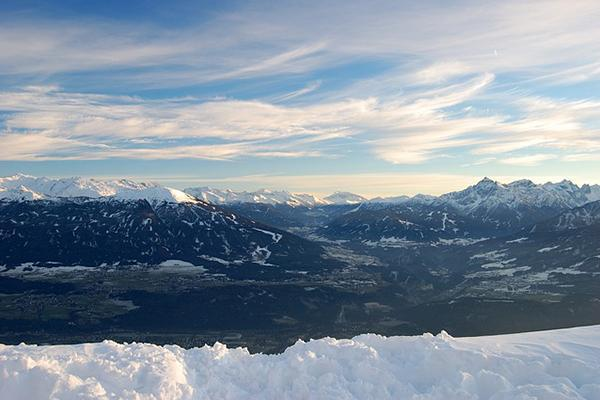 An expansive view of the snow-capped mountains of Innsbruck, Austria