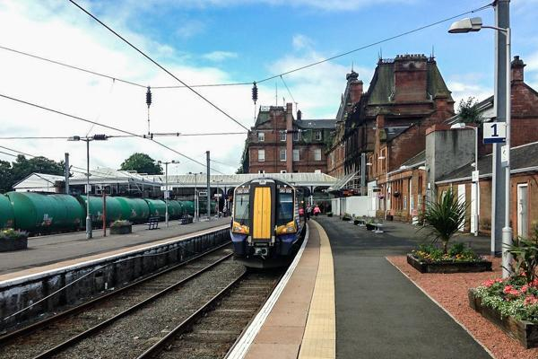 A train is docked at the Ayr Railway Station waiting to take passengers on their journey in Ayr, Scotland