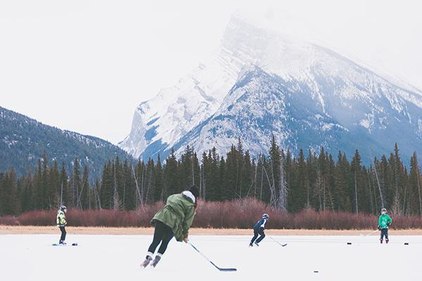People play hockey on a frozen lake in the Banff National Park in Alberta, Canada