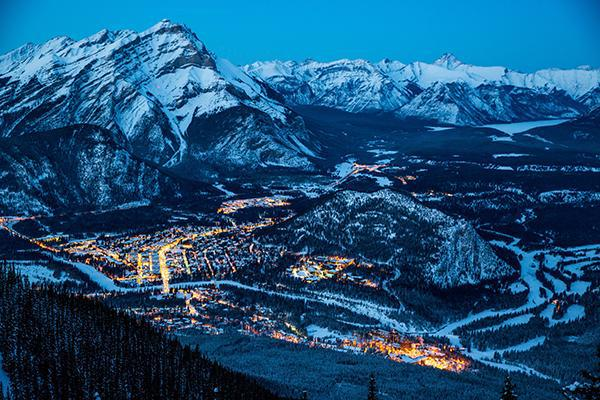 A view of Banff, Alberta at night from above the town