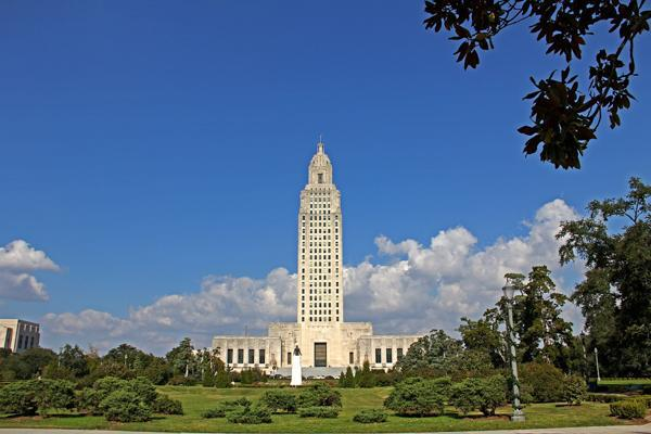 The State Capitol building stands tall on a sunny day in Baton Rouge, Louisiana