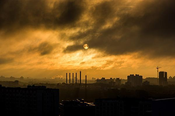 The sun washes orange over the Belarusian sky above Minsk as it sets behind the capital city.