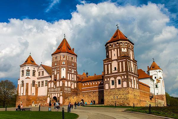 The Mir Castle stands proudly as visitors explore its grounds in Belarus