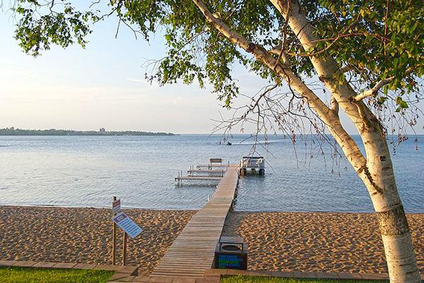 The relaxing scene of a dock leading out to Lake Bemidji at dusk in Bemidji, Minnesota