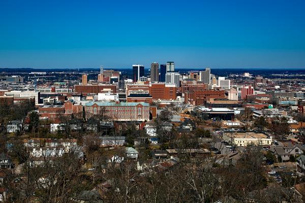 The skyline of Birmingham, Alabama rises amongst the surrounding suburbs
