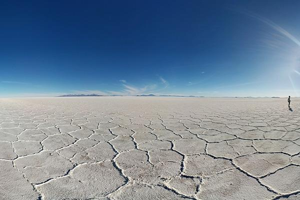 The unique landscape of the Bolivian salt flats contrast against the deep blue sky near the Dakar Monument in Bolivia