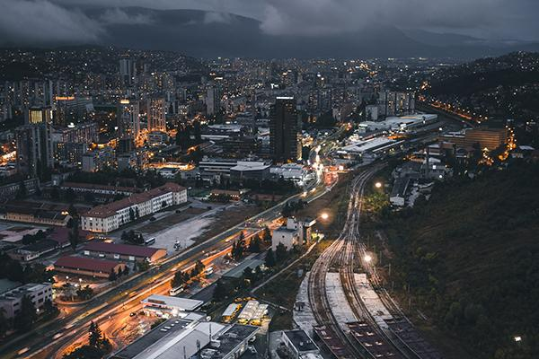 The crowded skyline of Sarajevo lights up the night in Bosnia and Herzegovina