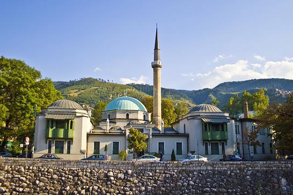 A mosque surrounded by lush greenery in Sarajevo, Bosnia-Herzegovina