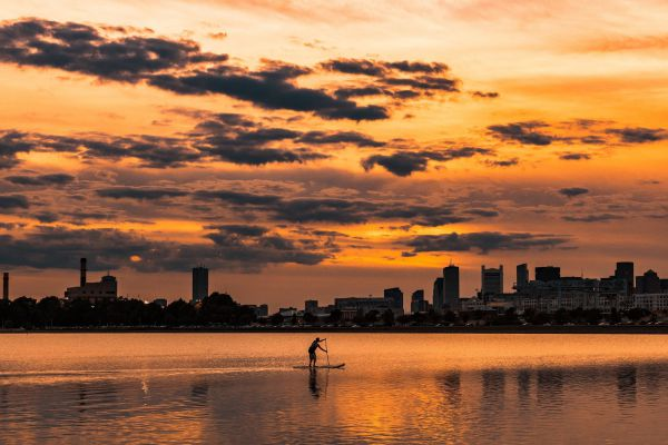 A paddle boarder paddles near Castle Island in South Boston, Massachusetts