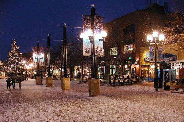 A dusting of snow covers the Pearl Street Mall in Boulder, Colorado