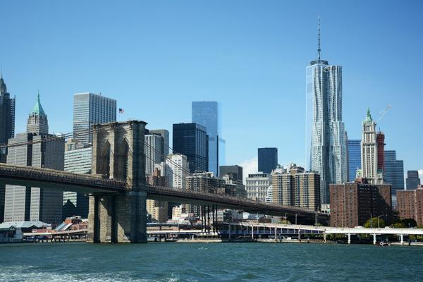 The Brooklyn Bridge hovers above the Hudson River leading you to Brooklyn, New York