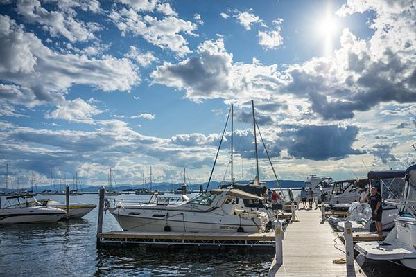 The sun shines brightly over boats docked in Lake Champlain, Burlington, Vermont