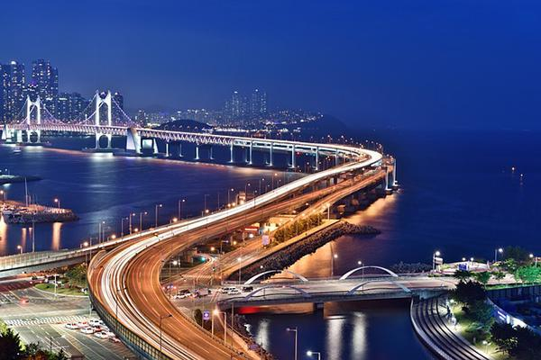Long exposure shot of the Gwangan Bridge at night in Busan, South Korea