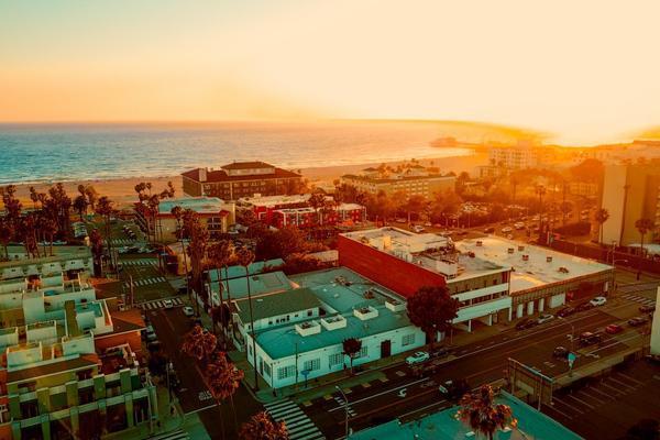 The sun sets on the beachside city of Santa Monica, California