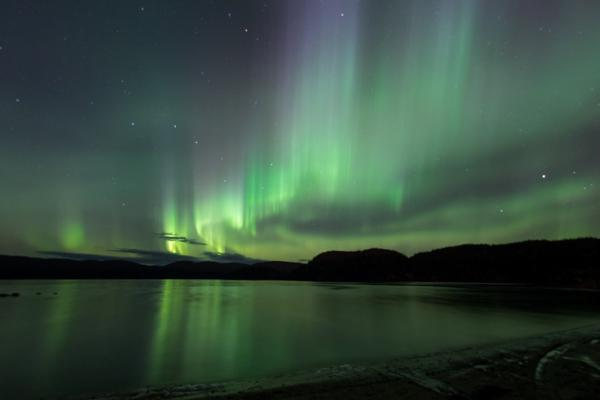 The aurora borealis lights up the night sky over Lac Rapide in Sept Iles, Canada