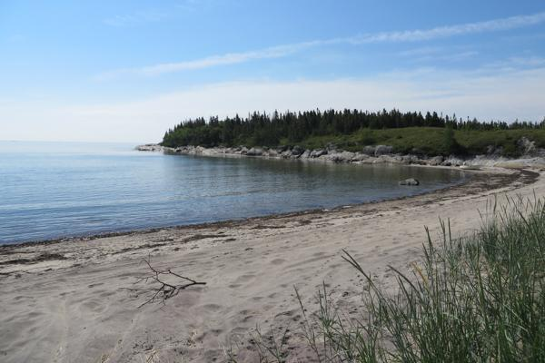 The beach Baie-des-Homards lies empty near Sept Iles, Canada