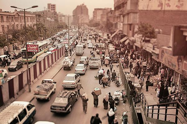 People go about daily life in the bustling centre of Cairo, Egypt