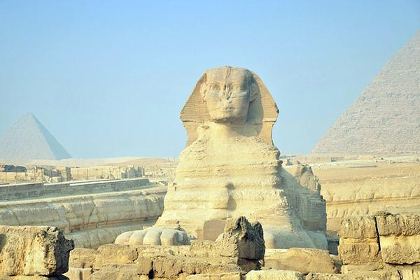 The Great Sphinx of Giza stands in front of the pyramids near Cairo, Egypt