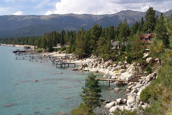 Houses and cabins line the shore of Lake Tahoe, California