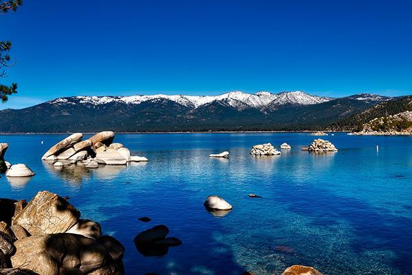 Beautiful Lake Tahoe in California with a mountain backdrop on a clear day