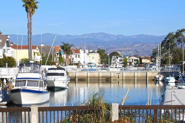 Boats line the marina in Oxnard, California on a sunny day
