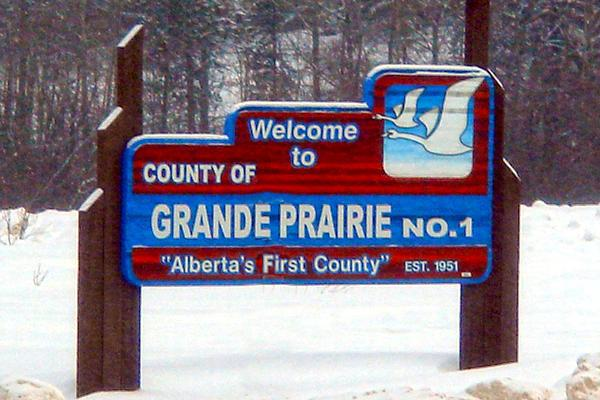 "Welcome sign in snow: Welcome to County of Grande Prairie ""Alberta's First County"""