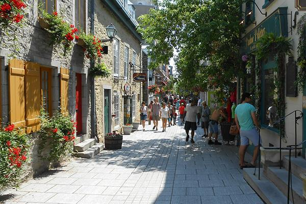 A flower-adorned pedestrian street in Quebec City, Canada