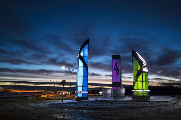 The colourful light towers at Fort McMurray International Airport shining brightly in Alberta, Canada