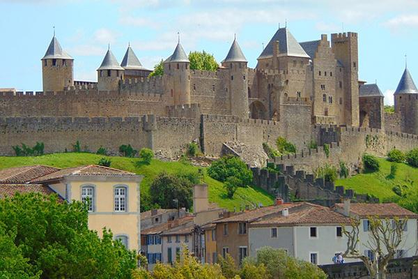 The medieval citadel, La Cité, stands proudly over the town of Carcassonne, France