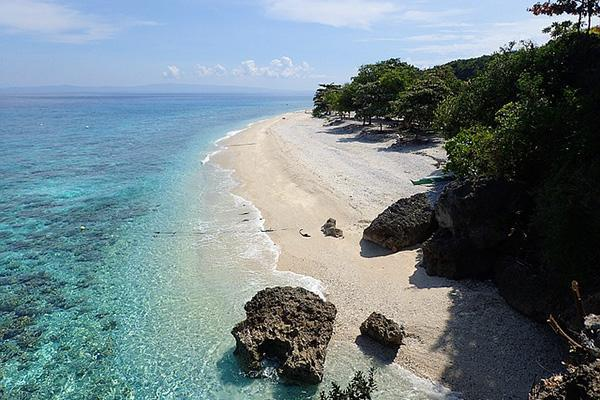Turquoise waters lap the sandy shores of Oslob on the island of Cebu in the Philippines
