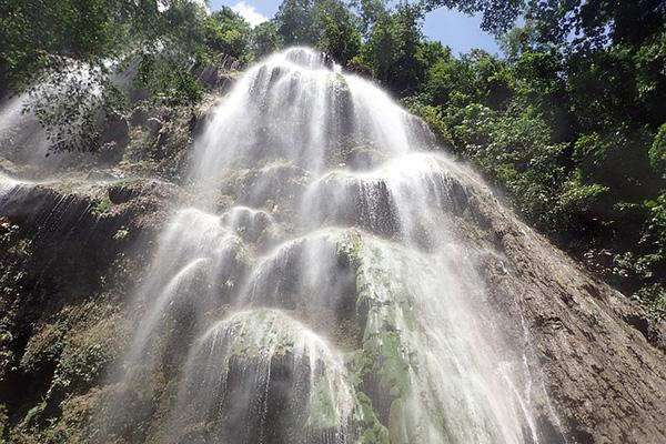A waterfall shimmers in the midday sun near Oslob on the island of Cebu in the Philippines