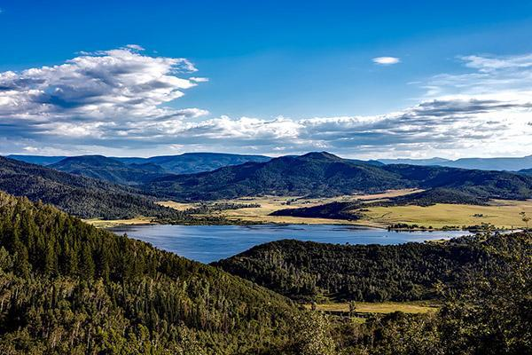 Lake Catamount reflects the blue sky on a sunny day near Hayden Colorado.