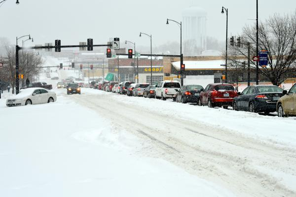 Snow covers the streets of Columbia, Missouri making difficult driving conditions