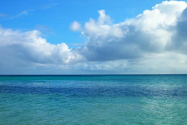 The inviting, emerald waters of the Cook Islands