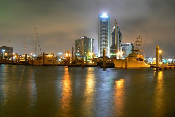 Boats sit in the marina as clouds pass over Corpus Christi, Texas
