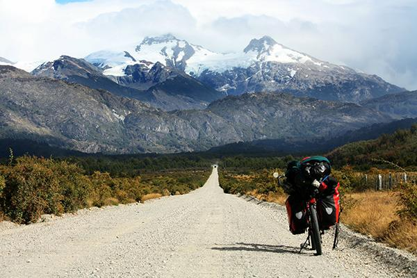 A bicycle sits facing the mountains on the unsealed Carretera Austral in Coyhaique, Chile