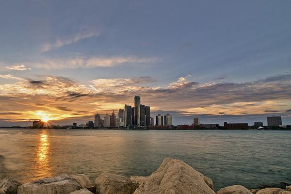 View of the Detroit skyline from across the water at sunset in Michigan