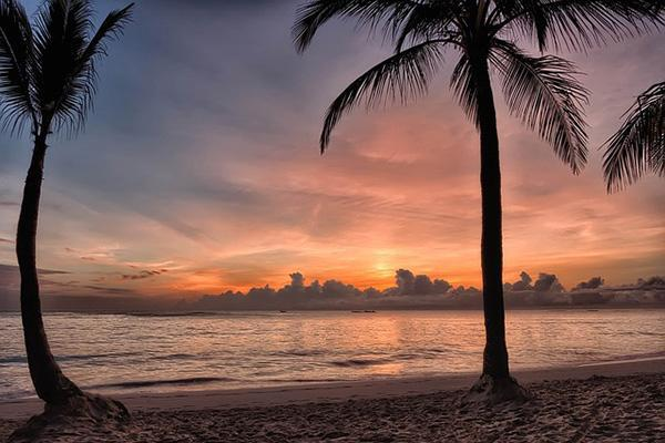 The setting sun paints the sky in pastel colours over a beach in Bavaro, Dominican