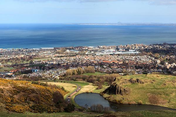 The view of Edinburgh and the sea beyond from Arthur's Seat in Scotland
