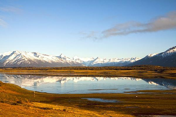 Snow-capped mountains reflect into water in Patagonia, near El Calafate, Argentina